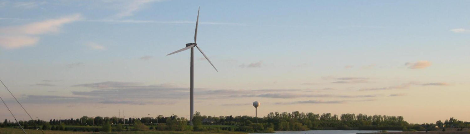 picture of wind turbine with Willmar water tower in the background