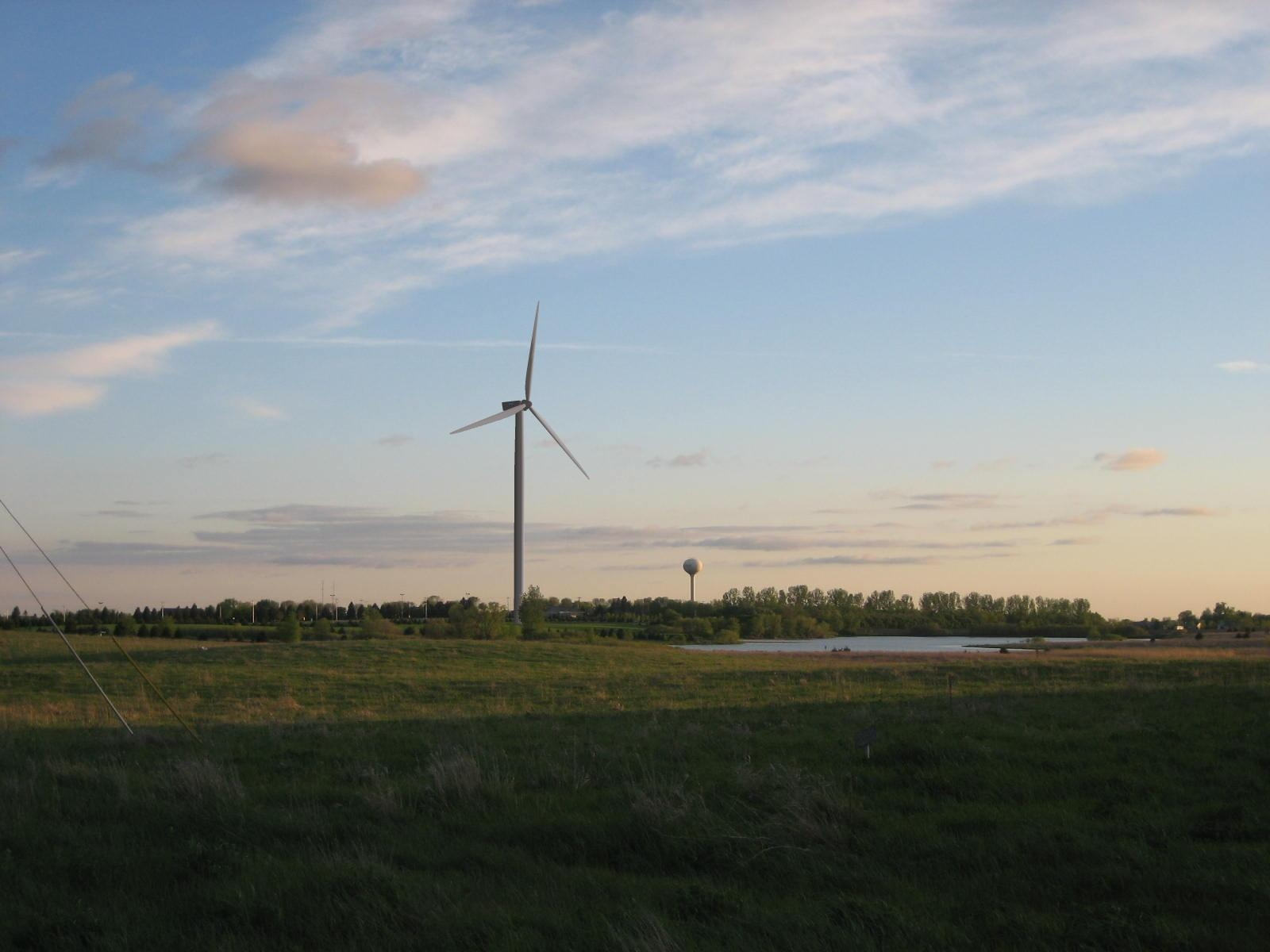 wind turbine in a field at sunrise